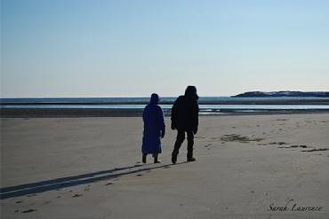 people walking on beach in winter photo by Sarah Laurence
